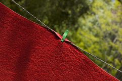 Red towel on wire Royalty Free Stock Image