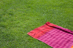 Red towell over the green grass Stock Image