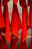Red towels hung on the wall Stock Images