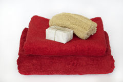 Red towels with soap and luffa Royalty Free Stock Photo