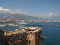 Red tower built in the 12th century to protect against attacks from the sea, Turkey, Alanya. Red tower built in the 12th century to protect against attacks from Stock Image