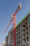 Red tower crane in construction site Royalty Free Stock Photography