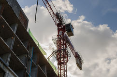 Red tower crane working in construction site Stock Photography