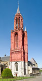 Red tower of the gothic St. John's church. Stock Photos