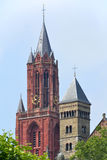 Red tower Saint Johns Church & one of Saint Servatius church towers Royalty Free Stock Images