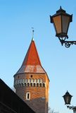 Red tower and street lamps royalty free stock image