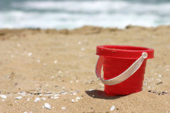 Red toy beach bucket Royalty Free Stock Image