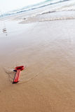Red toy on the beach. Red toy forgotten on the beach Royalty Free Stock Image