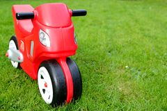 Red toy bike Stock Images