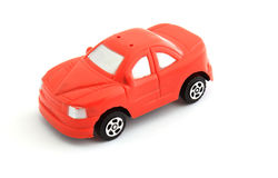Red toy car. A red toy car, as seen from the side royalty free stock image