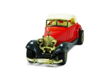 Red toy car 3. A isolated red and classic toy car Stock Photo
