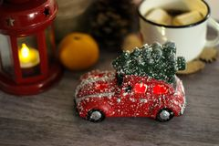 Red toy car with Christmas tree in the roof. Holiday concept stock image