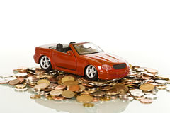 Red toy car on coins Stock Images