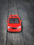 Red toy car on floor Royalty Free Stock Photography