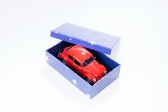 Red toy car in gift box. Red toy car in blue gift box Royalty Free Stock Photos