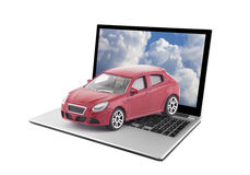 Red toy car on laptop Stock Image