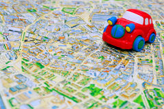 Red toy car on the map. Travel theme Royalty Free Stock Photos