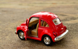 Red toy car. Park on the road royalty free stock photos
