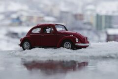 Red Toy Car in Snow royalty free stock image