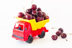 Red toy car with a sweet cherry Royalty Free Stock Photography