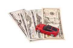 Red toy car on ten dollar banknotes, isolated on white  Stock Photography