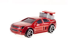 Red toy car on the white background Stock Photos