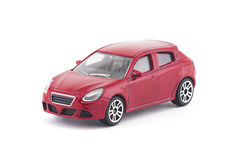 Red toy car on white background. With clipping path Stock Image
