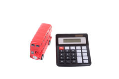 Red toy double-decker British bus and calculator Royalty Free Stock Photography