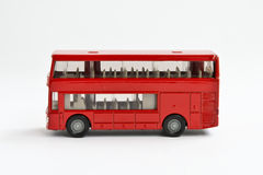 A double-decker bus. A red toy double-decker bus Stock Images