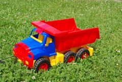 Red toy lorry. The big red toy lorry on a grass Stock Image