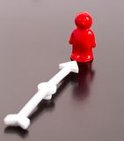 Red toy man and arrow Stock Image