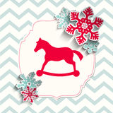 Red toy pony with abstract snowflakes on beige Stock Image