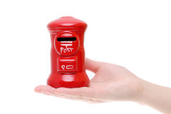 Red toy post box on the hand. Isolated on white background Stock Image