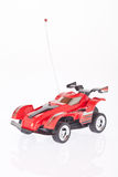 Red toy race car on white background Stock Photos