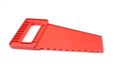 Red toy saw Royalty Free Stock Photography