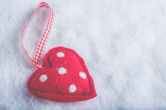Red toy suave heart on a frosty white snow background. Love and St. Valentine concept. Royalty Free Stock Images