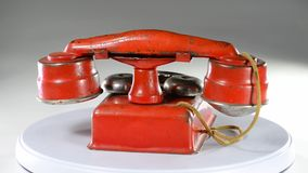 Red toy telephone. Red toy telephone made in the 1940`s stock video footage