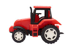 Red toy Tractor Isolated on white background.  Royalty Free Stock Image