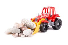 Red toy tractor on a white Stock Photos