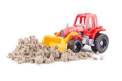 Red toy tractor on a white Royalty Free Stock Photos