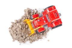 Red toy tractor on a white Royalty Free Stock Image