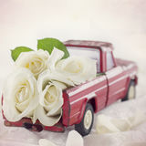 Red toy truck with white roses Royalty Free Stock Photography