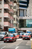 Red Toyota Comfort taxicabs go on street Royalty Free Stock Images