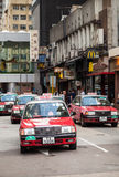 Red Toyota Comfort taxicabs go on the street Royalty Free Stock Photo