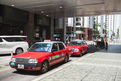 Red Toyota Comfort taxicabs stand on the street Royalty Free Stock Photography