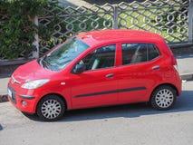 Red Toyota Yaris car in Milan Royalty Free Stock Photos