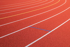 Red track lanes turn. Track lanes diagonal and turn to the left on a red rubber track stock photography