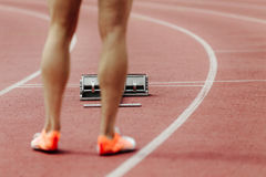 Red track and starting blocks Royalty Free Stock Photos