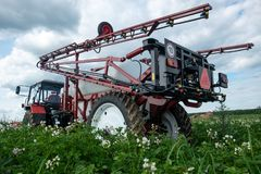 Red tracktor sprayer in the field royalty free stock photos