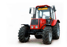 Red tractor. Closeup of red farm tractor isolated on white background Stock Image